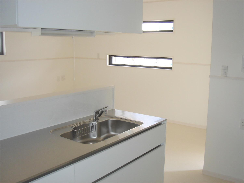 アパートタイプの二階建てのキッチン つくば市の注文住宅,ログハウスのような低価格住宅を建てるならエイ・ワン