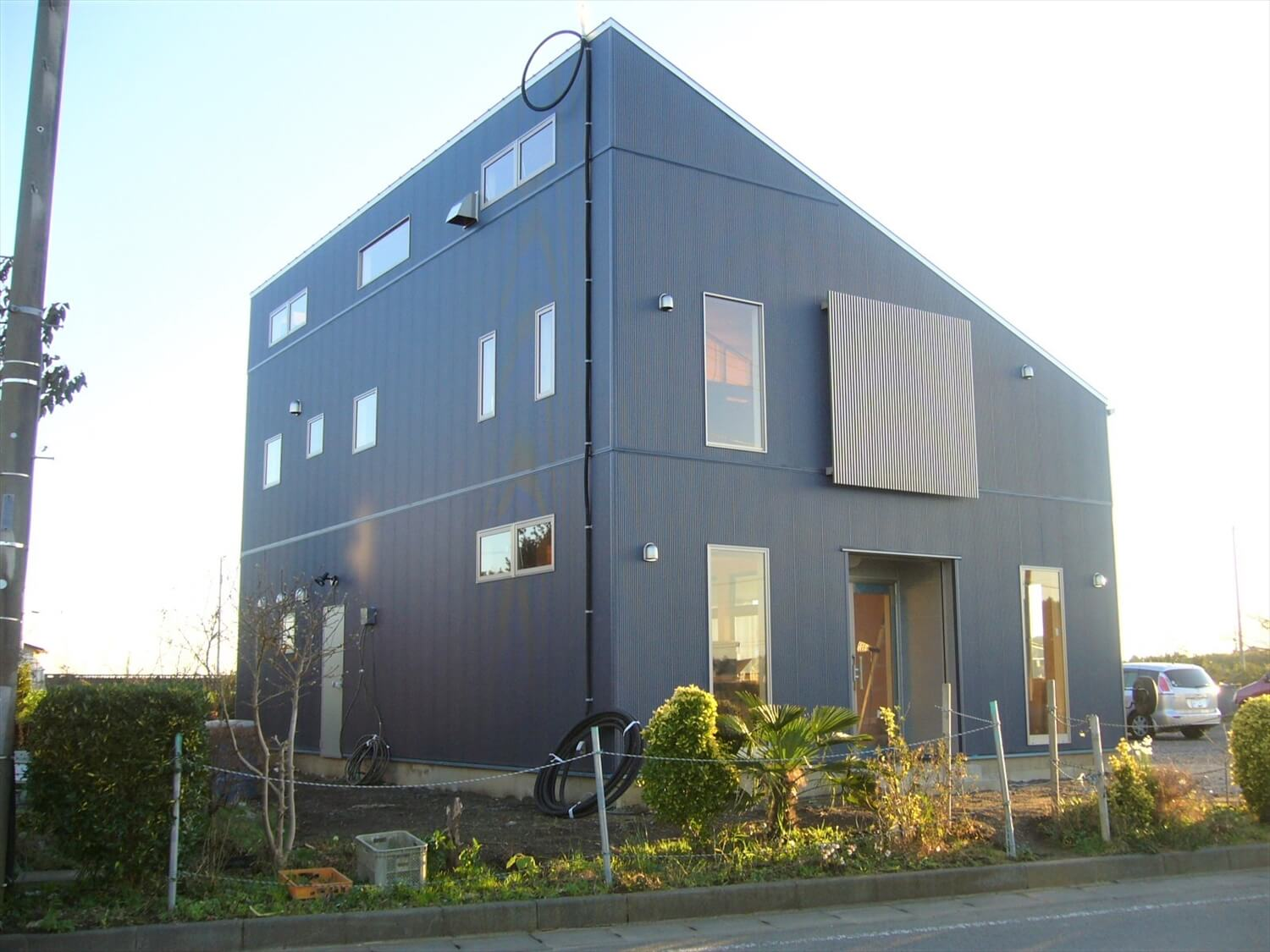 二階建ての作業所の外観 鹿嶋市の注文住宅,ログハウスのような低価格住宅を建てるならエイ・ワン